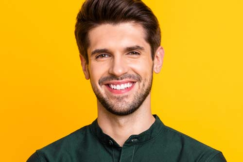 cosmetic dentistry man in green collar shirt
