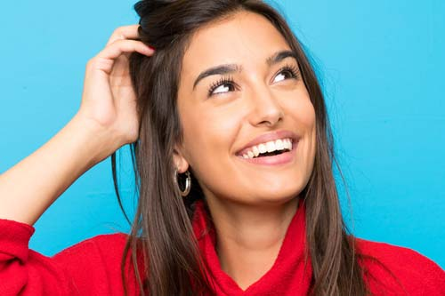 specialist services woman in red turtleneck smiling