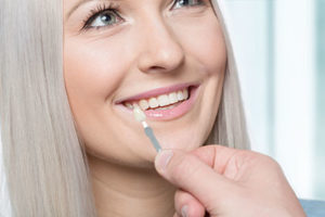 a woman getting fitted for dental veneers tx