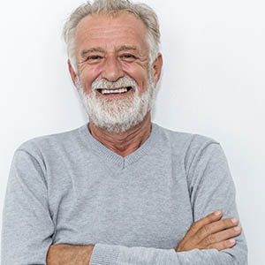 a man smiling at lovett dental missouri city services