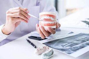 dentist explaining Oral Pathology