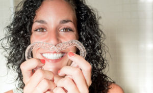 woman shows off her soft orthodontic braces