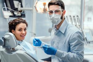doctor walks patient through the process of ridge augmentation