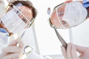doctors address a dental emergency on a patient