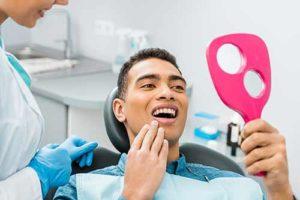 man gets a dental exam