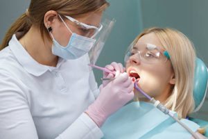 a woman receives treatment at a specialty dentist